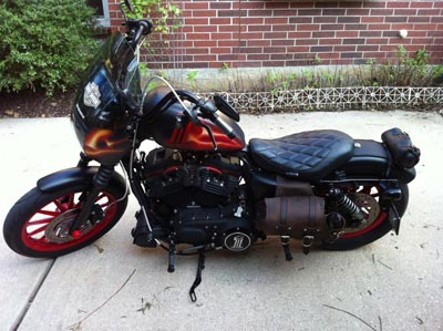 matte black harley custom painted with true fire in red, orange and yellow